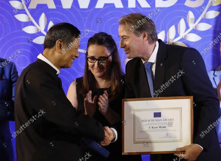 EU Ambassador to Myanmar Kristian Schmidt (R) gives Schuman Awards to Human rights Lawyer Kyee Myint (L), during Schuman Awards ceremony at the EU Ambassador residence in Yangon, Myanmar, 19 February 2020. The European Union in Myanmar gives the annual Schuman Awards to recognize outstanding merits in the promotion of universal values of democracy, rule of law, peace and human rights. Human rights Lawyer Kyee Myint, Women's Rights activist Lway Poe Ngeal from Women's League of Burma and The Peacock Generation Thangyat (The satirical poet group) are the recipients of this year's 2020 Schuman Awards.