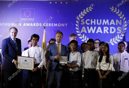 EU Ambassador to Myanmar Kristian Schmidt (L) and Netherlands Ambassador to Myanmar Wouter Jurgens (C) give Schuman Awards to The Peacock Generation Thangyat (The satirical poet group), during Schuman Awards ceremony at the EU Ambassador residence in Yangon, Myanmar, 19 February 2020. The European Union in Myanmar gives the annual Schuman Awards to recognize outstanding merits in the promotion of universal values of democracy, rule of law, peace and human rights. Human rights Lawyer Kyee Myint, Women's Rights activist Lway Poe Ngeal from Women's League of Burma and The Peacock Generation Thangyat (The satirical poet group) are the recipients of this year's 2020 Schuman Awards.