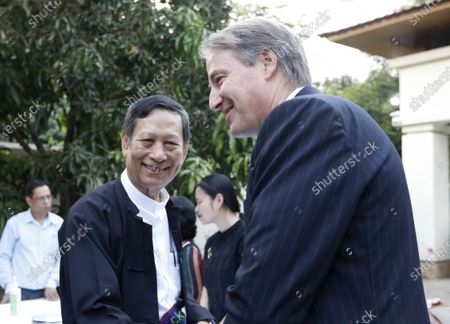 Stock Image of Lawyer Kyee Myint (L) greets EU Ambassador to Myanmar Kristian Schmidt (R) during Schuman Awards ceremony at the EU Ambassador residence in Yangon, Myanmar, 19 February 2020. The European Union in Myanmar gives the annual Schuman Awards to recognize outstanding merits in the promotion of universal values of democracy, rule of law, peace and human rights. Human rights Lawyer Kyee Myint, Women's Rights activist Lway Poe Ngeal from Women's League of Burma and The Peacock Generation Thangyat (The satirical poet group) are the recipients of this year's 2020 Schuman Awards.