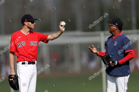Chris Sale, Pedro Martinez. Boston Red Sox starting pitcher Chris Sale, left, talks with Pedro Martinez during spring training baseball camp, in Sarasota, Fla