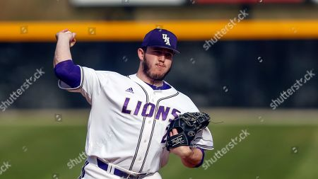 North Alabama's Austin Nichols (21) throws a pitch during an NCAA college baseball game, in Florence, Ala
