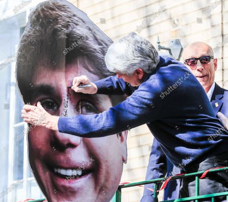 Former Illinois Governor Rod Blagojevich autographs a large image of himself after speaking for the first time since his release from federal prison at his home in Chicago, Illinois, USA, 19 February 2020. Blagojevich served eight years of a 14 year federal prison sentence after being convicted of corruption. His sentence was commuted by US President Donald J. Trump on 18 February.