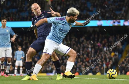 Manchester City's Sergio Aguero, right, and West Ham's Pablo Zabaleta battle for the ball during the English Premier League soccer match between Manchester City and West Ham at Etihad stadium in Manchester, England