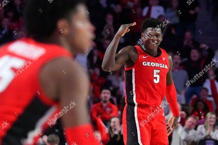 Georgia guard Anthony Edwards (5) celebrates a shot by guard Sahvir Wheeler, left, during the second half of an NCAA college basketball game Auburn, in Athens, Ga. Georgia won 65-55