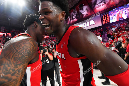 Georgia guard Anthony Edwards, right, and forward Mike Peake celebrate after an NCAA college basketball game against Auburn, in Athens, Ga. Georgia won 65-55