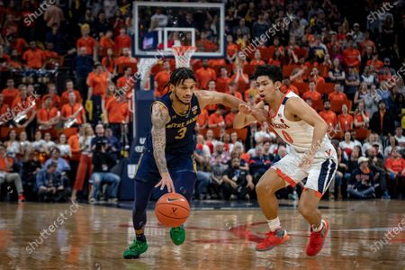 Notre Dame Guard Prentiss Hubb (3) and Virginia Guard Kihei Clark (0) during the NCAA Basketball game between the University of Notre Dame Fighting Irish and the University of Virginia Cavaliers at John Paul Jones Arena in Charlottesville, VA