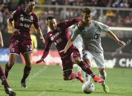 Amar Sejdic of Canada's Montreal Impact, right, fights for the ball with midfielder David Guzman of Costa Rica's Deportivo Saprissa during a CONCAFAF Champions League soccer match at the Ricardo Saprissa Stadium in San Jose, Costa Rica