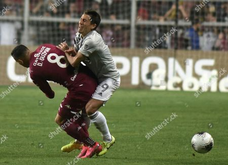 Stock Picture of David Guzman, left, of Costa Rica's Deportivo Saprissa collides with midfielder Bojan Krkic of Canada's Montreal Impact during a CONCAFAF Champions League soccer match at the Ricardo Saprissa Stadium in San Jose, Costa Rica