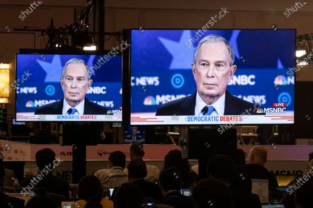 Journalists look at screens broadcasting the ongoing debate as Democratic Presidential candidate, former NYC Mayor Michael R. Bloomberg, speaks on stage during the ninth Democratic presidential debate at the Paris Theater in Las Vegas, Nevada, USA, 19 February 2020.