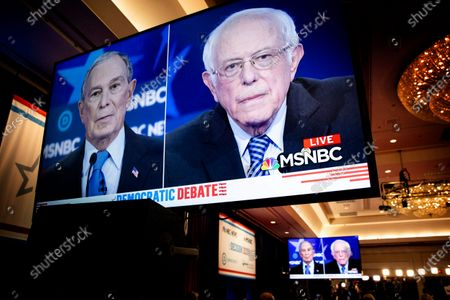 Screens broadcast images of former NYC Mayor Michael R. Bloomberg and Vermont Senator Bernie Sanders as they participate in the ninth Democratic presidential debate at the Paris Theater in Las Vegas, Nevada, USA, 19 February 2020.