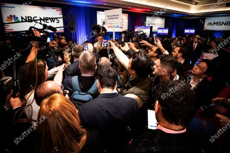 Journalists surround a representative of Former NYC Mayor Michael R. Bloomberg following the ninth Democratic presidential debate at the Paris Theater in Las Vegas, Nevada, USA, 19 February 2020. The US presidential elections are scheduled fro 03 November 2020.
