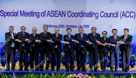 Saifuddin Abdullah, Kyaw Tin, Teodoro Locsin Jr., Vivian Balakrishnan, Don Pramudwinai, Ph?m Binh Minh, Erywan Yusof, Prak Sokhon, Retno Marsudi, Saleumxay Kommasith, Dato Lim Jock Hoi. Foreign ministers of The Association of Southeast Asian Nations (ASEAN) from left, Malaysia's Foreign Minister Saifuddin Abdullah, Myanmar's Minister of State for Foreign Affaires Kyaw Tin, Philippines' Foreign Affaires Secretary Teodoro Locsin Jr., Singapore's Foreign Minister Vivian Balakrishnan, Thailand's Foreign Minister Don Pramudwinai, Vietnam's Deputy Prime Minister and Foreign Minister Ph?m Binh Minh, Brunei's Second Minister of Foreign Affairs and Trade Erywan Yusof, Cambodia Foreign Minister Prak Sokhon, Indonesia Foreign Minister Retno Marsudi, Laos Foreign Minister Saleumxay Kommasith, and ASEAN Secretary General Dato Lim Jock Hoi shake hands in ASEAN style ahead of the Special Meeting of the ASEAN coordination council in Vientiane, Laos