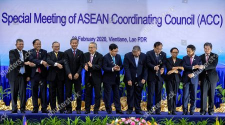 Saifuddin Abdullah, Kyaw Tin, Teodoro Locsin Jr., Vivian Balakrishnan, Don Pramudwinai, Pham Binh Minh, Erywan Yusof, Prak Sokhon, Retno Marsudi, Saleumxay Kommasith, Dato Lim Jock Hoi. Foreign ministers of The Association of Southeast Asian Nations (ASEAN) from left, Malaysia's Foreign Minister Saifuddin Abdullah, Myanmar's Minister of State for Foreign Affaires Kyaw Tin, Philippines' Foreign Affaires Secretary Teodoro Locsin Jr., Singapore's Foreign Minister Vivian Balakrishnan, Thailand's Foreign Minister Don Pramudwinai, Vietnam's Deputy Prime Minister and Foreign Minister Ph?m Binh Minh, Brunei's Second Minister of Foreign Affairs and Trade Erywan Yusof, Cambodia's Foreign Minister Prak Sokhon, Indonesia's Foreign Minister Retno Marsudi, Laos' Foreign Minister Saleumxay Kommasith, and ASEAN Secretary General Dato Lim Jock Hoi applaud after posing for a group photo ahead of the Special Meeting of the ASEAN coordination council in Vientiane, Laos