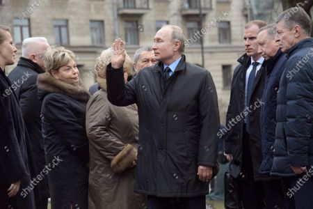 Deputy Chief of Staff of the Presidential Administration of Russia Dmitry Kozak (right), Governor of Saint Petersburg Alexander Beglov (second from right), Russian President Vladimir Putin (center), Owner of Brocade Vintage Boutique Elena Zilberkwit (second from left) and Russian TV host Ksenia Sobchak (left) are seen before the flower-laying ceremony at the Monument to the First Mayor of Saint Petersburg, Anatoly Sobchak.