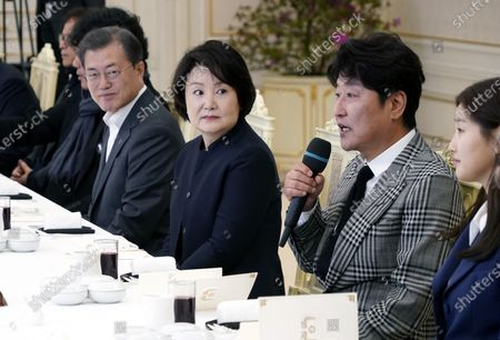Stock Picture of Actor Song Kang-ho (2-R) of the movie Parasite speaks next to South Korean President Moon Jae-in (L) and first lady Kim Jung-sook (2-L) during a luncheon at the Presidential Blue House in Seoul, South Korea, 20 February 2020.