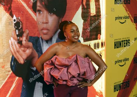 """Jerrika Hinton, a cast member in the Amazon Prime Video series """"Hunters,"""" poses at the premiere of the show at the Directors Guild of America, in Los Angeles"""