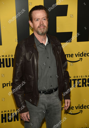 """Stock Image of Dylan Baker, a cast member in """"Hunters,"""" poses at the premiere of the show at the Directors Guild of America, in Los Angeles"""