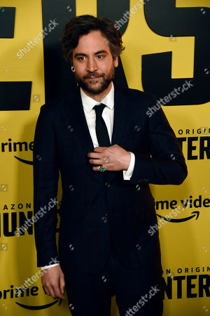 """Josh Radnor, a cast member in the Amazon Prime Video series """"Hunters,"""" poses at the premiere of the show at the Directors Guild of America, in Los Angeles"""