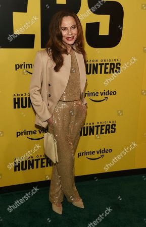 "Lena Olin, a cast member in the Amazon Prime Video series ""Hunters,"" poses at the premiere of the show at the Directors Guild of America, in Los Angeles"
