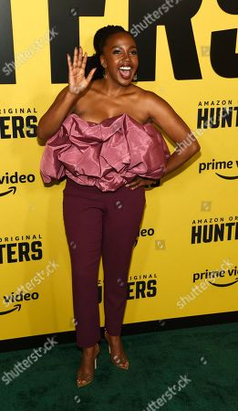 """Jerrika Hinton, a cast member in the Amazon Prime Video series """"Hunters,"""" waves to photographers at the premiere of the show at the Directors Guild of America, in Los Angeles"""
