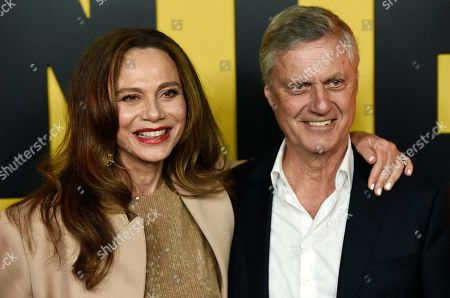 "Lena Olin, Lasse Hallstrom. Lena Olin, left, a cast member in the Amazon Prime Video series ""Hunters,"" and her husband, director Lasse Hallstrom, pose together at the premiere of the show at the Directors Guild of America, in Los Angeles"
