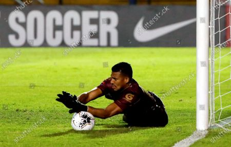 Stock Photo of Comunicaciones FC's goalkeeper Jose Calderon catches a ball during a round 16 Concacaf Champions League match between America de Mexico and Comunicaciones FC, at the Doroteo Guamuch Stadium in Guatemala City, Guatemala, 19 February 2020.