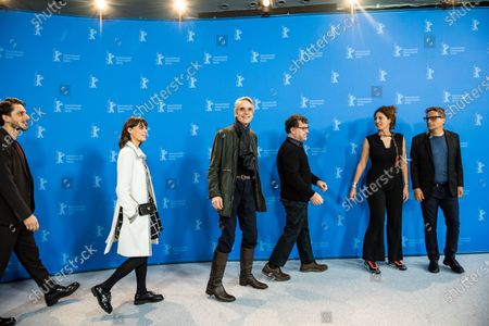 Luca Marinelli (Italy), Actress Berenice Bejo (France / Argentina), jury president and actor Jeremy Irons (UK), playwright and filmmaker Kenneth Lonergan (USA), programmer, director Annemarie Jacir (Palestine) and film critic and director Kleber Mendonca Filho (Brazil) pose during the International Jury' photocall during the 70th annual Berlin International Film Festival (Berlinale), in Berlin, Germany, 20 February 2020. The movie is presented in the Official Competition at the Berlinale that runs from 20 February to 01 March 2020.