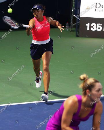 Shuai Zhang (L) of China and Gabriela Dabrowski (R) of Canada in action during their doubles quarter final match against Lyudmyla Kichenok and Nadiia Kichenok of Ukraine at the Dubai Duty Free Tennis WTA Championships 2020 in Dubai, United Arab Emirates, 20 February 2020.