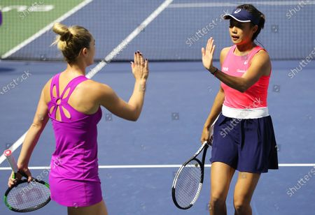 Shuai Zhang (R) of China and Gabriela Dabrowski (L) of Canada react during their doubles quarter final match against Lyudmyla Kichenok and Nadiia Kichenok of Ukraine at the Dubai Duty Free Tennis WTA Championships 2020 in Dubai, United Arab Emirates, 20 February 2020.