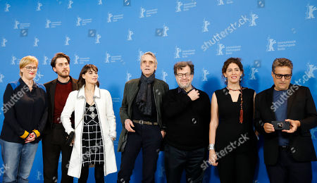 The jury of then 70th International Film Festival Berlin, Berlinale, producer Bettina Brokemper, actor Luca Marinelli, actress Berenice Bejo, jury president actor Jeremy Irons, filmaker Kenneth Lonergan, director Annemarie Jacir and author and director Kleber Mendonaa Filho, from left, pose for a photo prior to a news conference in Berlin, Germany