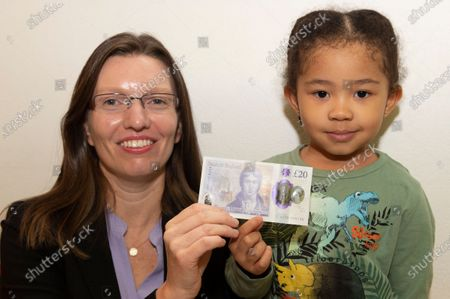 Bank of England Chief Cashier and Director of Notes Sarah John (L) and 3 year old Lily Ruva Tang (R) pose with the new £20 banknote. Sarah John's signature is featured on the new banknote.