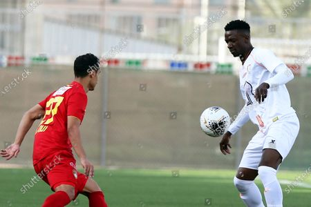 Damac's Abdullah Al-Joui (L) in action against Al-Shabab's Hassan Muath Fallatah (R) during the Saudi Professional League soccer match between Al-Shabab FC and Damac FC at Prince Khalid Bin Sultan Stadium in Riyadh, Saudi Arabia, 20 February 2020.
