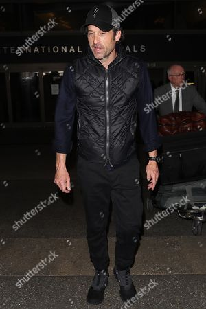 Editorial picture of Patrick Dempsey and Jillian Fink out and about at LAX International Airport, Los Angeles, USA - 19 Feb 2020