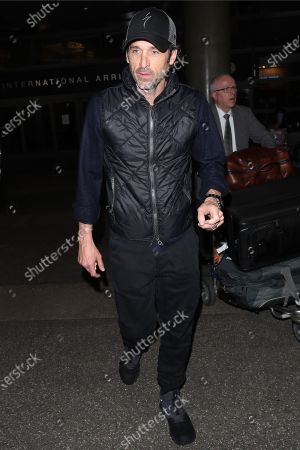 Editorial photo of Patrick Dempsey and Jillian Fink out and about at LAX International Airport, Los Angeles, USA - 19 Feb 2020