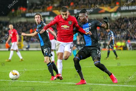 Manchester United midfielder Andreas Pereira (15) tussles with Club Brugge defender Simon Deli (17) during the Europa League match between Club Brugge and Manchester United at Jan Breydel Stadion, Brugge