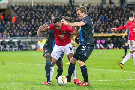 Manchester United forward Anthony Martial (9) tussles with Club Brugge defender Odilon Kossounou (5) and Club Brugge midfielder Ruud Vormer (25) during the Europa League match between Club Brugge and Manchester United at Jan Breydel Stadion, Brugge