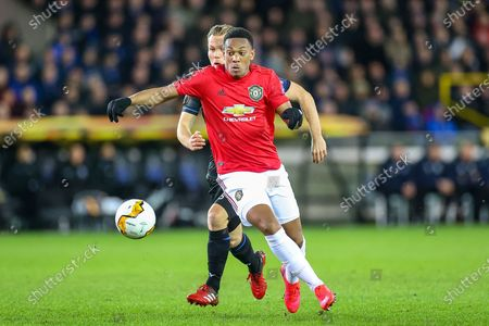 Manchester United forward Anthony Martial (9) shields the ball from Club Brugge midfielder Ruud Vormer (25) during the Europa League match between Club Brugge and Manchester United at Jan Breydel Stadion, Brugge