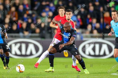 Manchester United midfielder Andreas Pereira (15) tussles with Club Brugge midfielder Eder Balanta (3) during the Europa League match between Club Brugge and Manchester United at Jan Breydel Stadion, Brugge
