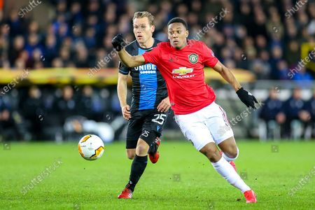 Manchester United forward Anthony Martial (9) beats Club Brugge midfielder Ruud Vormer (25) during the Europa League match between Club Brugge and Manchester United at Jan Breydel Stadion, Brugge