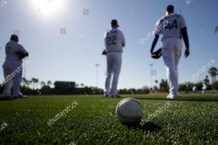 Stock Image of Los Angeles Dodgers pitcher Clayton Kershaw, center, waits with pitcher Zach McAllister, right, during spring training baseball, in Phoenix