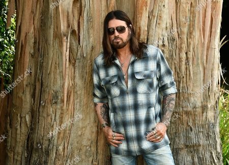 "Stock Picture of Billy Ray Cyrus poses for a portrait at his home in Los Angeles on. The Kentucky-born singer won his first Grammy this year for his collaboration with rapper Lil Nas X on ""Old Town Road."" He's releasing a three-song EP on Friday, ""The Singin' Hills Sessions Vol. 1 Sunset"
