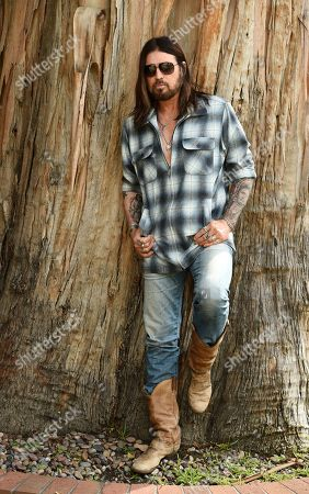 "Billy Ray Cyrus poses for a portrait at his home in Los Angeles on. The Kentucky-born singer won his first Grammy this year for his collaboration with rapper Lil Nas X on ""Old Town Road."" He's releasing a three-song EP on Friday, ""The Singin' Hills Sessions Vol. 1 Sunset"