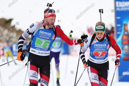 Simon Eder (L) of Austria hands over to Lisa Theresa Hauser (R) during the Single Mixed Relay race at the IBU Biathlon World Championships in Antholz/Anterselva, Italy, 20 February 2020.