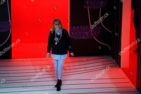 Miuccia Prada acknowledges the applauses at the end of her Prada women's Fall-Winter 2020-2021 fashion show, that was presented in Milan, Italy