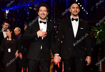 Stock Photo of Fahri Ogün Yardim (L) and Andreas Bourani (R) arrive for the Opening Ceremony of the 70th annual Berlin International Film Festival (Berlinale), in Berlin, Germany, 20 February 2020. The Berlinale runs from 20 February to 01 March 2020.