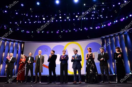 Stock Image of Host Samuel Finzi, Berlinale managing director Mariette Rissenbeek and Berlinale artistic director Carlo Chatrian on stage with International Jury president Jeremy Irons, and Jury members Luca Marinelli, Bettina Brokemper, Kenneth Lonergan, Annemarie Jacir, Kleber Mendonca Filho, and Berenice Bejo during the Opening Ceremony of the 70th annual Berlin International Film Festival (Berlinale), in Berlin, Germany, 20 February 2020. The Berlinale runs from 20 February to 01 March 2020.
