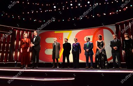 Stock Photo of Berlinale managing director Mariette Rissenbeek and Berlinale artistic director Carlo Chatrian on stage with International Jury president Jeremy Irons, and Jury members Luca Marinelli, Bettina Brokemper, Kenneth Lonergan, Annemarie Jacir, Kleber Mendonca Filho, and Berenice Bejo during the Opening Ceremony of the 70th annual Berlin International Film Festival (Berlinale), in Berlin, Germany, 20 February 2020. The Berlinale runs from 20 February to 01 March 2020.