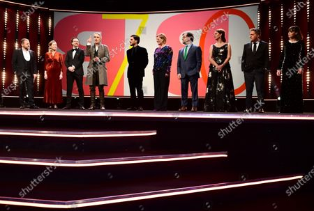 Host Samuel Finzi, Berlinale managing director Mariette Rissenbeek and Berlinale artistic director Carlo Chatrian on stage with International Jury president Jeremy Irons, and Jury members Luca Marinelli, Bettina Brokemper, Kenneth Lonergan, Annemarie Jacir, Kleber Mendonca Filho, and Berenice Bejo during the Opening Ceremony of the 70th annual Berlin International Film Festival (Berlinale), in Berlin, Germany, 20 February 2020. The Berlinale runs from 20 February to 01 March 2020.
