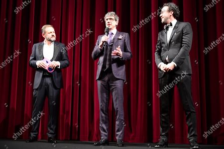Philippe Falardeau (C) speaks on stage next to host Samuel Finzi (L) and Berlinale artistic director Carlo Chatrian (R) during the Opening Ceremony of the 70th annual Berlin International Film Festival (Berlinale), in Berlin, Germany, 20 February 2020. The Berlinale runs from 20 February to 01 March 2020.