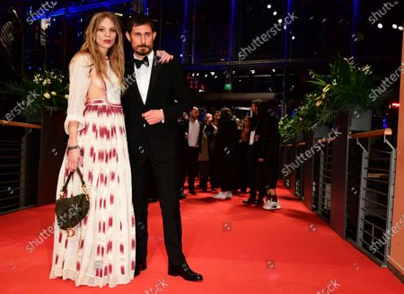 Stock Photo of Lilith Stangenberg (L) and Clemens Schick (R) arrive for the Opening Ceremony of the 70th annual Berlin International Film Festival (Berlinale), in Berlin, Germany, 20 February 2020. The Berlinale runs from 20 February to 01 March 2020.